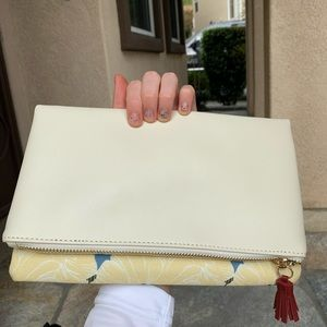 leather and canvas floral clutch